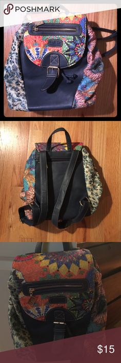 Small backpack perfect for travel!! Small gorgeous multi-colored backpack! Bought on posh for small travel day trips! Easy and great around town bag! Bags Backpacks