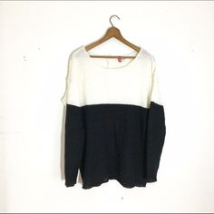 """H&M Divided Monochromatic Sweater H&M Divided black and white sweater with drop sleeves. Very lightly worn. Buttons by the neck in the back. Size medium. Measures about 26"""" long. Pair this with a pair of distressed boyfriend jeans for an effortlessly chic look! H&M Sweaters Crew & Scoop Necks"""
