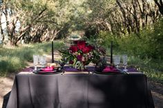 Full of dark vivid colors, skulls, and a moody vibe, this styled shoot has an edgy feel for a modern take on the classic Halloween theme.