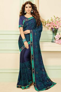 This all new chiffon saree collection is one of its kind. Exaggerated with Mukaish work in beautiful patterns, this printed chiffon saree in Dark blue color is teamed with Dark blue chiffon blouse and Matching santoon underskirt. Bridal Silk Saree, Chiffon Saree, Silk Sarees, Dark Blue Color, Traditional Sarees, Saree Collection, Beautiful Patterns, Half Sleeves, Indian Beauty