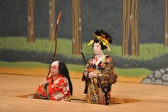 Kabuki performers being raised/lowered through a trap door