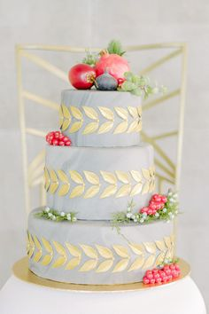Soft grey wedding cake with gold leaf detaiol   A Colorful Wedding Shoot in…