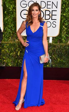 WOW~ Cindy Crawford... looks amazing in this thigh high split, royal blue Versace gown with embellished detail at the 2015 Golden Globes