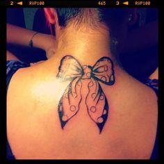 Bow tattoo by Valentina Magrì