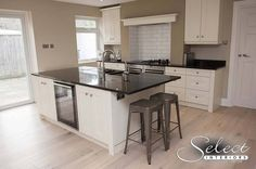 Black stone kitchen island and bar by Landford Stone with Select Interiors.
