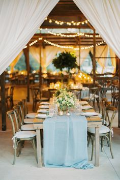 """From the editorial """"When East Coast Style Meets the West at an Elegant Seaside Bluff Affair in Santa Barbara."""" Half of the tables were exposed wood with natural gray runners, candles, and abundant arrangements of flowers. The other half were round tables with gray velvet linens and tall gold stands with large arrangements of greenery. Everything about this reception setup was beyond dreamy!  LBB Photography: @nataliebrayphoto  #barnreception #weddingreception #receptiondecor #receptiondesign Black Tie Wedding, Elegant Wedding, Rustic Wedding, East Coast Style, Grey Runner, Reception Design, Wedding Venues, Wedding Ideas, Wedding Images"""