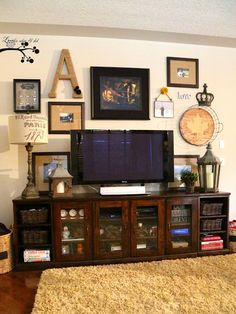 "eclectic gallery wall around the TV....need to do something like this with all of our ""treasures"""