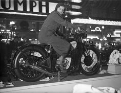 A woman trying out a Douglas motorcycle on display at the 18th Cycle and Motorcycle Show in London, 1933. A. Hudson/Topical Press Agency/Hulton Archive / Getty Images
