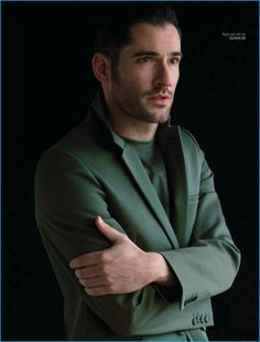 Tom Ellis dons a green suiting number from Calvin Klein.