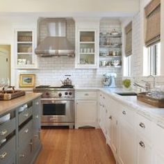 traditional kitchen by Taste Design Inc grey & white cabinets