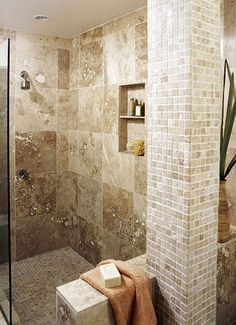 The tile and glass expand the depth of view of the shower space and give this shower a very roomy feel. I spent a little extra and bought custom glass doors that swing in and out, thus expanding the depth of my master's small bathroom and shower. Well worth the few extra dollars.