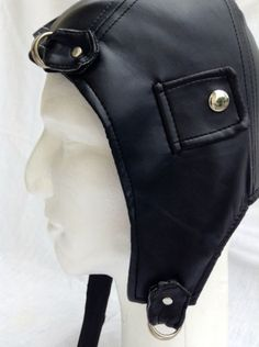 Old time flying ace black aviator helmet. Perfect for a Steampunk theme costume or party with stitching detail, steel studs on ear flaps and two steel buckles. One size fits all. $19.95