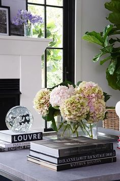 Love fresh flowers and a stack of books - perfect for styling the coffee table!