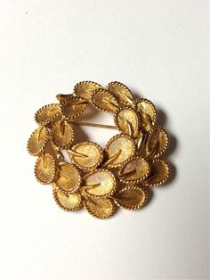 Vintage 1960s Trifari Gold Tone Wreath Brooch by pinkpoppyvintage on Etsy