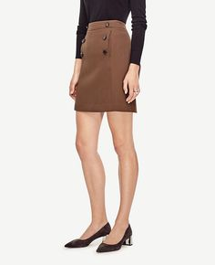 "Cut in a flattering A-line silhouette, this smooth doublecloth skirt polishes off your look with smart button detail. Contoured waistband. Vertical on-seam pockets. Hidden back zipper with hook-and-eye closure. Lined. 19"" long."