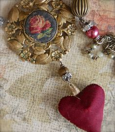 The Love of Needlepoint-Antique Vintage Worn Needlepoint Brooch and Hand Made Heart Assemblage Necklace by Opaline1214 on Etsy https://www.etsy.com/listing/180220855/the-love-of-needlepoint-antique-vintage