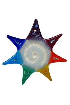 """This colorful Rainbow Star is beautiful and has a sparkly pink/yellow dichroic spot at the center as well as dichroic spots on the arms. It is made by Charlotte Behrens in Mt. Carroll, IL. It measures about 5"""" in diameter.   Glass Rainbow Star by Charlotte Behrens. Home & Gifts - Home Decor - Decorative Objects Cleveland, Ohio"""