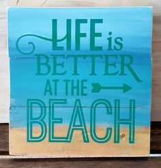 """10.5"""" x 11"""" wooden sign This pallet sign hasa gradient background that mimics the sand, water and sky of the beach and features turquoise/green lettering. dist"""