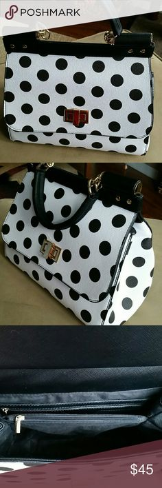 """Beautiful polka dot bag Black & white polka dot. Bought brand new, and tried it for 1 week, and though I absolutely love polka dots on anything; this bag was just a tad too big for me. Twist front gold tone closure, 2 seperate sections inside, with a zipper pocket dividing the 2. Outside zipper pocket, inside two slide pockets and one back zipper pocket. Comes with shoulder strap, adjustable to even use as a cross body.  Hate to see this go, but know I will not use. 12""""x10.5h""""x7""""w. Bags…"""