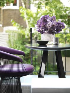 Kelly Hoppen Couture - Kelly Hoppen Interiors like the idea to match flowers to feature furniture