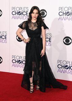 Kat Dennings wore a vampy black lace dgown