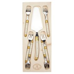 """Serve in style at your next summer soiree with this eye-catching essential, offering country-chic charm for your well-dressed table.      Product: 1 Cake knife, 6 cake forks and storage tray          Construction Material: Wood and steel    Color: Ivory    Features: Arrives in a decorative box    Dimensions: 0.5"""" H x 10.5"""" W x 2.5"""" D (overall)    Cleaning and Care: Hand wash with care"""