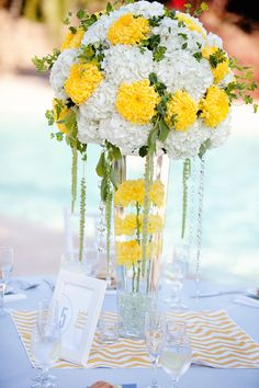 Bright and sunny white and yellow centerpiece - Photo by April Smith & Co.