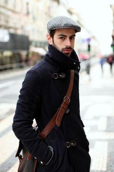 Shop this look on Lookastic:  https://lookastic.com/men/looks/navy-overcoat-brown-leather-messenger-bag-grey-plaid-flat-cap/4768  — Brown Leather Messenger Bag  — Grey Plaid Flat Cap  — Navy Overcoat
