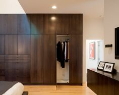 I like this look, it is mutli-purpose. Houses your clothing, and adds interest and warmth to the bedroom!!