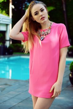 statement necklace with pastel pink shirtdress