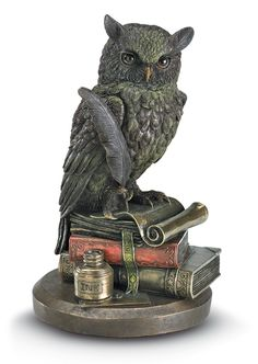 Owl and Books Don't just take our word that the owl is the symbol of wisdom - this one has done the research. Learned owl stands proudly on a pile of books, composing a treatise on owl wisdom. Cold-cast bronze with subtle coloration.