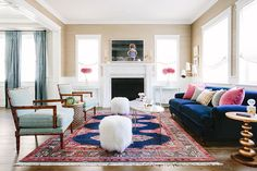 We're touring a stunning living room and kitchen nook in Southern California, plus getting tips for nailing the designer look for less.