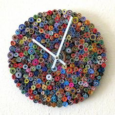 Just roll with it! This unusual and colorful recycled wall clock is an eco-friendly solution for your timing needs. Whether you are at home or the office, this exceptional timepiece keeps time faithfu
