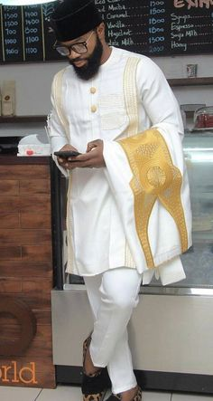 This elegant outfit is handmade with love. The shirt is designed with high quality materials and also high tailoring standards. It is suitable for all kinds of occasion. This set comes with a matching agbada, shirt and pant. The pant is styled with a draw string for wearers ease Buyers can request