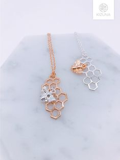 Shiny honeycomb necklace with bee pendant.