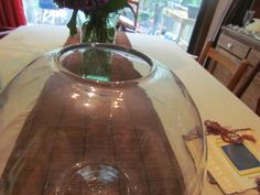 This the large, hand-blown glass vase that the flowers on the altar will go in.