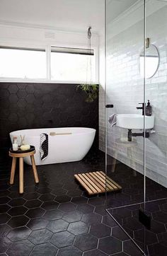 Awesome 10 Magnificent Black Bathroom Floor Tile Ideas To Make Your Activities Comfortable Are you looking for ideas for your bathroom floor? The selection of the right bathroom floor not only makes activities in the bathroom more enjoyable . Black Bathroom Floor Tiles, Modern Bathroom Tile, Diy Bathroom, Bathroom Tile Designs, Bathroom Interior Design, Bathroom Flooring, White Bathroom, Small Bathroom, Bathroom Ideas