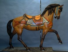 Circa 1905 Muller From PTC #9 - $27,500 Last operated in Pine Grove, PA Simple, yet graceful, realistic and powerful lines. Handsome face, appearing in deep, even philisophical thought. All beautifully restored in colored stains by Pam Hessey.