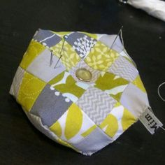 Using up some scraps + vintage buttons to make a grellow pincushion. 4/365