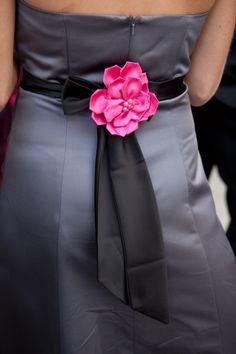 a cute way to dress up the black dresses just use fall color flowers and match your shoes to it