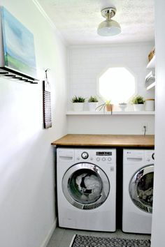 Modern white laundry room makeover with DIY plywood countertop and white appliances. Wood accents, Emily Jeffords inspired painting, DIY organizational floating shelves, and lots of greenery. Laundry Decor, Laundry Room Organization, Laundry Room Design, Laundry Tips, Laundry Area, Plywood Countertop, Laundry Room Countertop, Bathroom Laundry, Small Bathroom