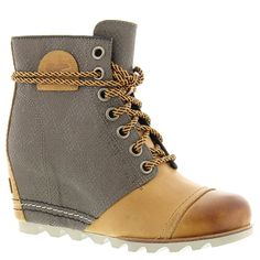 Sorel 1964 Premium Wedge Boot - Women's Elk 10. Upper: Waterproof full-grain leather and textile. Microfiber lining. Footbed: Removable molded EVA footbed with heel cup and arch support, synthetic topcover. Midsole: Molded BPU-PU wedge. Outsole: Molded rubber outsole.
