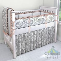 Crib bedding in Gray Traditions Damask, Solid Antique White, Solid Peach. Created using the Nursery Designer® by Carousel Designs where you mix and match from hundreds of fabrics to create your own unique baby bedding. #carouseldesigns