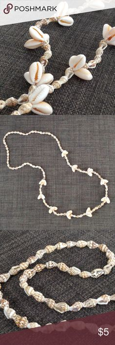 "Uniquely? beautiful shell necklace Bought on an beach trip but never wore; perfect condition!  Super cute accent to your vacation looks and boho outfits!    Real shells, about 32"" long.  Price is firm because it's so low.  Bundle to save 10%! Jewelry Necklaces"