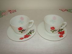 Vintage JAJ June Rose Pyrex cups and saucers. Two cups and two saucers in the JAJ June Rose pattern. All in very good vintage condition, no chips or cracks and the rose pattern is crisp and clear. Very pretty and very collectable. Would look great on display in your kitchen. All items have the JAJ back stamp. Cups 7cm high Saucers 15cm across Please see all pictures.