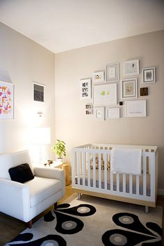 i have no need for a crib, but i'm loving the soft lighting, color of the walls, plus the rug. also feeling the group of framed prints.
