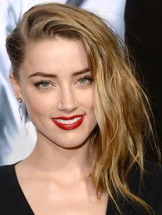 Amber Heard wears her hair tight on one side for a faux undercut http://beautyeditor.ca/2014/02/14/fake-an-undercut/