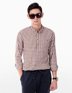 Never go wrong on style with this check mandarin collar shirt. To style this piece, wear it with white cuffed chino pants and a pair of two-tone oxford shoes. - Mandarin collars - Long sleeves - Square cuffs - Button neck closure - Button chest pocket - Check pattern - Colors: Black, Gray, Ivory