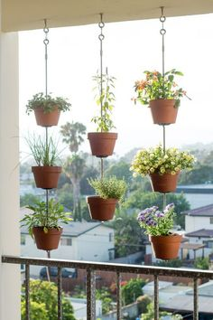 Create an urban garden in small homes with hanging plant pots suspended with rope. Perfect for balcony's. More at http://www.redonline.co.uk