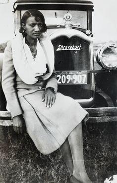 An African American woman sitting on car bumper, Shreveport, Louisiana, circa 1931. The Burns Archive